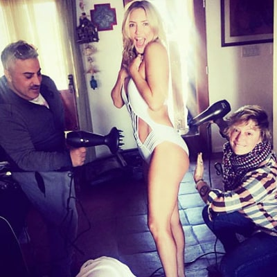 Kate Hudson Poses in a Swimsuit While Her Glam Squad Keeps Her Warm With Blow-Dryers