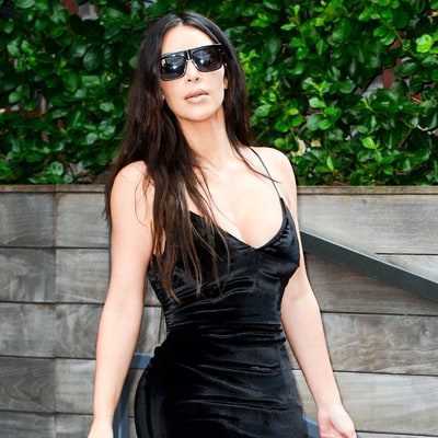 Kim Kardashian Steps Out in a Velvet Dress With Snakeskin Boots