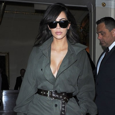 Kim Kardashian Covers Up in an Olive Jumpsuit for Anniversary Date Night