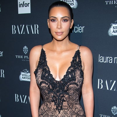 Kim Kardashian Poses Nude as She Shows Off Her Midnight Spray Tan