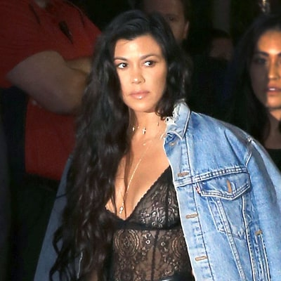 Kourtney Kardashian Channels Kim With a Sexy Bodysuit and 'Pablo' Denim Jacket