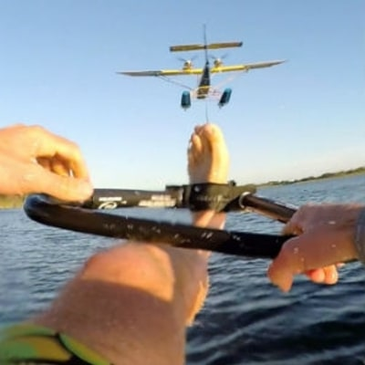 Watch a Barefoot Water Skier Get Towed by an Airplane