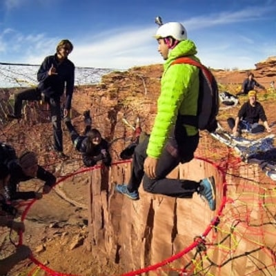 Watch a BASE Jumper Drop Through a Space Net