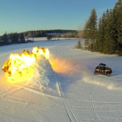 Watch a Dune Buggy and a Motorcycle Race Across a Frozen Lake