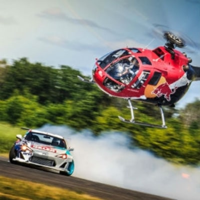 Watch Felix Baumgartner Chase a Drift Car With a Helicopter