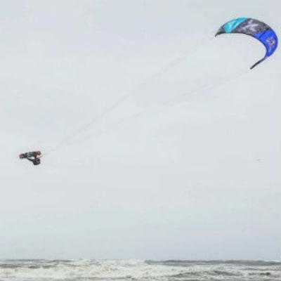 Watch Kiteboarders Soar 40 Feet High in a Rainstorm