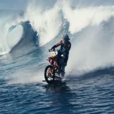 Watch Robbie Maddison Surf Teahupo'o on a Motorbike