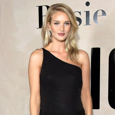 Pregnant Rosie Huntington-Whiteley Shows Off Her Baby Bump on the Red Carpet for the First Time