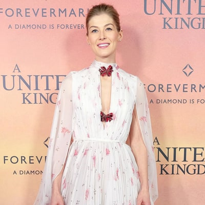 Rosamund Pike Sprouts Up in a Floral Caped Minidress