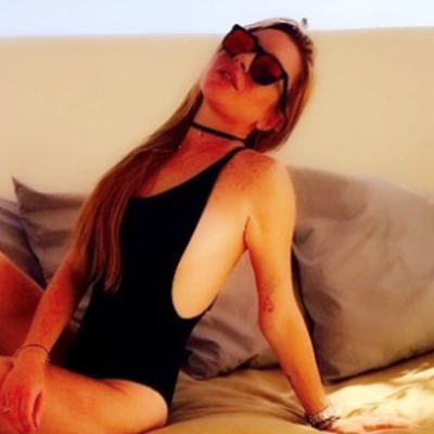 Lindsay Lohan Shows Off Her Lithe Body in a Cutout One-Piece Swimsuit