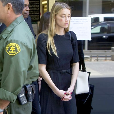 Amber Heard Looks Somber, Bruised Leaving Court After Accusing Johnny Depp of Domestic Violence