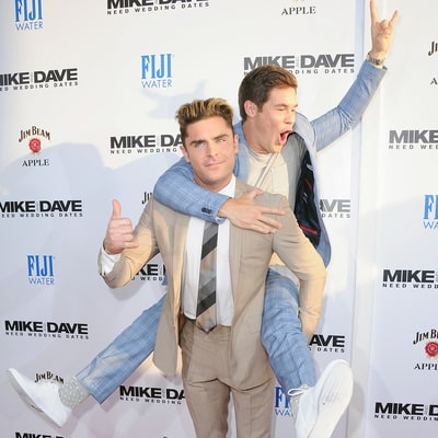 Zac Efron Looks Undisturbed as Adam Devine Jumps Onto His Back at the 'Mike & Dave' Premiere